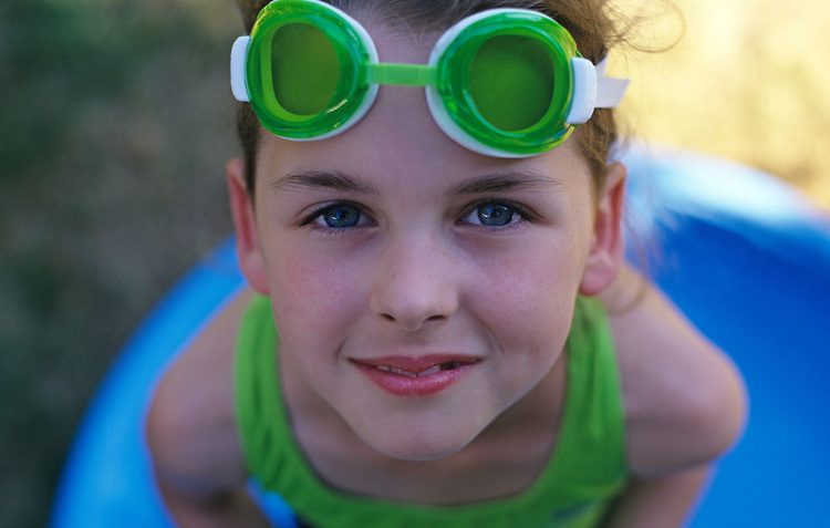 Young girl ( 9 yrs old) with water goggle smiling