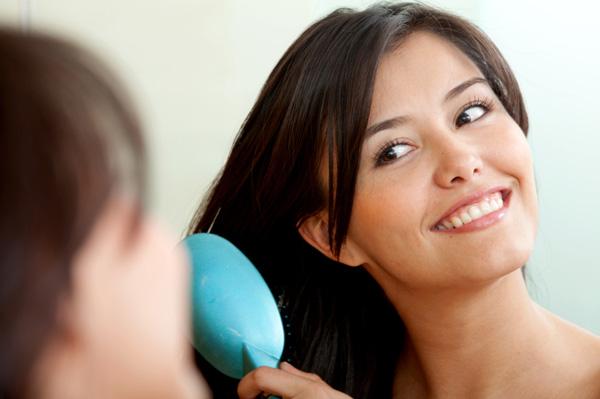 woman-brushing-hair-with-natural-brush