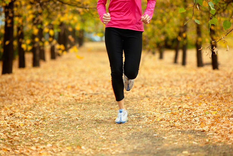 woman-running-fall-leaves