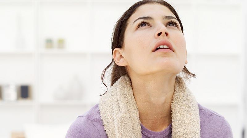 woman-towel-neck-workout