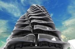 ساختمانی با طبقات متحرک!+عکس