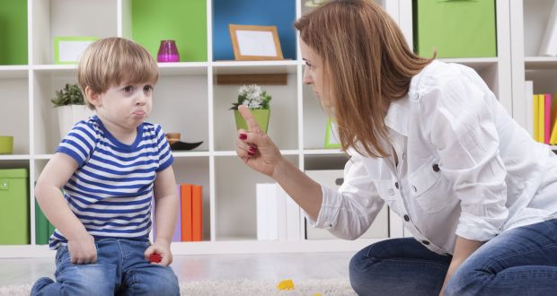 Angry mother scolding a disobedient child