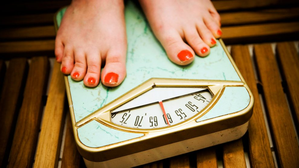 woman-on-weight-scale